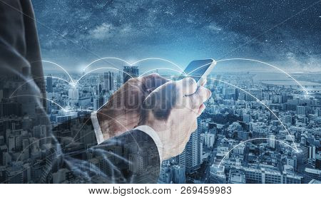 Double Exposure Businessman Using Mobile Smart Phone, And Network Connection Technology In The City.