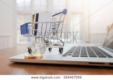 Business And Finance Concept,  Close Up Shopping Cart With Credit Card And Bitcoin On Desk For E-com