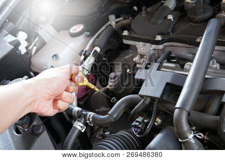 Mechanic Man Working And Repair Car Engine In Car Service Centre.automobile Metal Car Engine Part De
