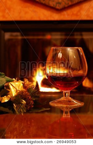 Christmas brandy by fireplace