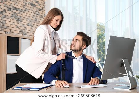 Woman Molesting Her Male Colleague In Office. Sexual Harassment At Work