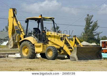 Tractor Fitted With A Backhoe And Scoop