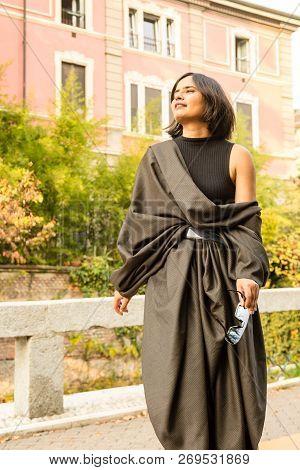 Indian Woman Posing In An Urban Context