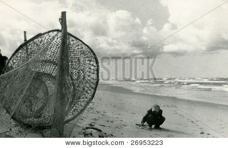 Vintage photo of girl on a beach (fifties)