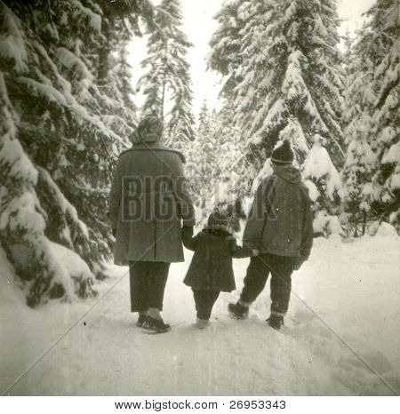 Vintage photo of happy family in winter setting (fifties)