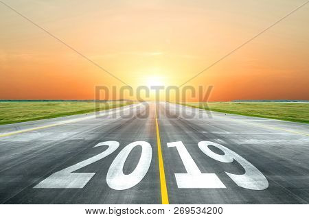 View Of The Peaceful Open Road Against The Setting Sun Forward To New 2019 Year. Concept Of Success