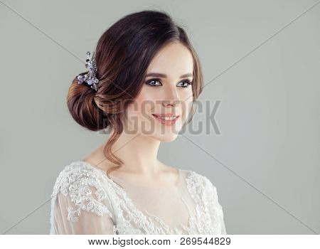 Cheerful Woman With Bridal Updo Hair, Portrait