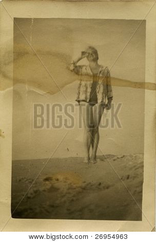 Vintage unretouched dirty photo of young woman (fifties)