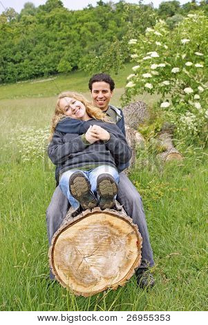 Inter-ethnic couple relaxing outdoor