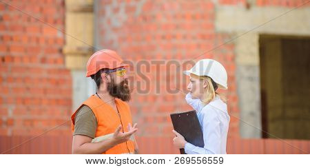 Safety inspector concept. Construction site safety inspection. Discuss progress project. Woman inspector and bearded brutal builder discuss construction progress. Construction project inspecting poster