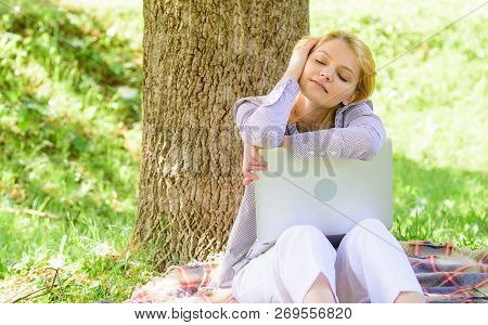 Dream About New Job Or Relocation. Girl Laptop Dreaming In Park Sit On Grass. Dream About Successful