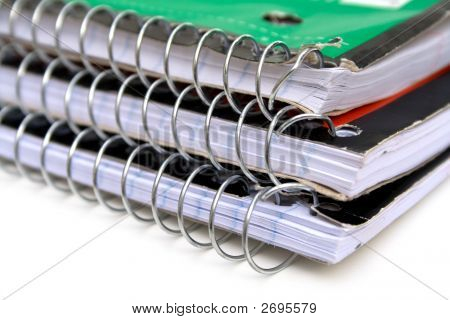 A stack of three spiral ring school