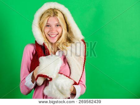 Woman Emotional Face Posing In Warm Furry Hood. Girl Cheerful Blonde Warming Up Wear Fur Hood On Gre