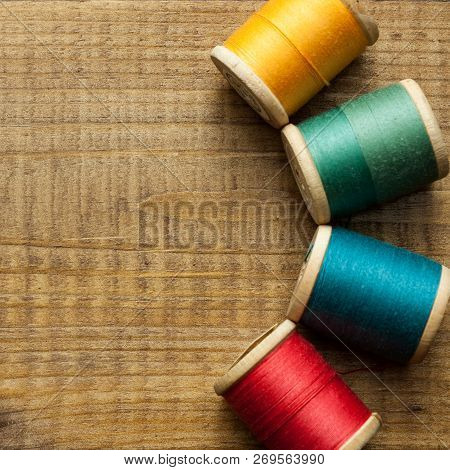 Old Wooden Coils Of Thread.