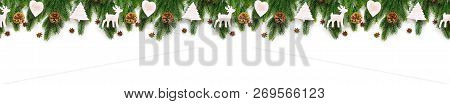 Christmas Tree Branches On White Background As A Border