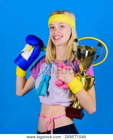 Girl Successful Modern Woman Hold Golden Goblet Of Champion. Woman Good In Tennis Jumping Boxing Fit