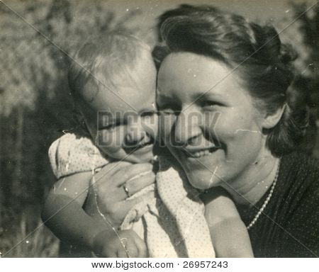 Vintage photo of mother and baby daughter (fifties)