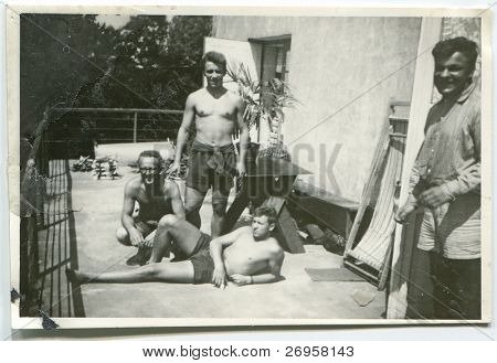 Vintage photo of father with sons (fifties)