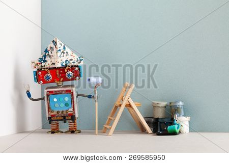 Smiley Robot Painter Decorator With Paint Roller Buckets And Wooden Ladder. Renovation Interior Apar