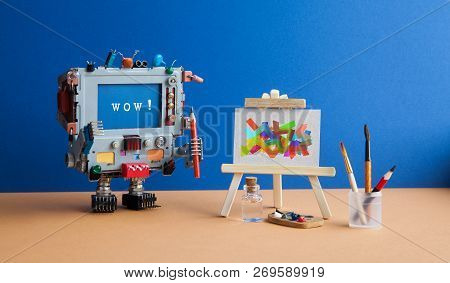 Art And Artificial Intelligence Concept. Surprised Robot Computer With Pencil Brush And Message Wow