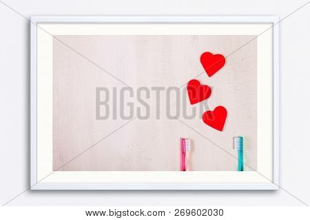 Love Concept With Hearts And Toothbrushes. Valentines Day Design On Wood Vintage Background. Wooden