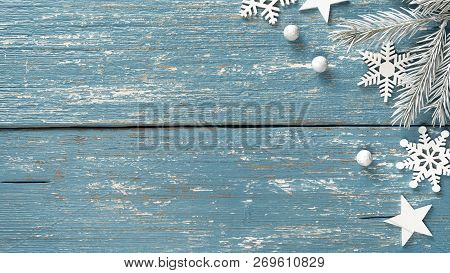 White Christmas Fir Tree Branches Decorative Snowflakes And Stars On Vintage Blue Wooden Rustic Back