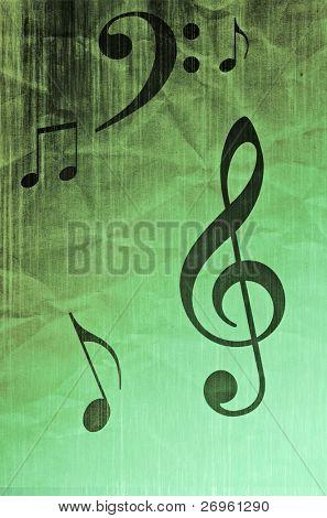 Music symbols on grunge creased paper