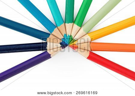 Eleven Coloured Pencils Arranged In An Arc On White Background