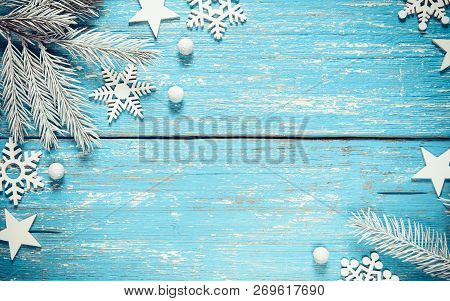White Christmas Fir Tree Branches White Snowflakes And Stars On Vintage Blue Wooden Rustic Backgroun