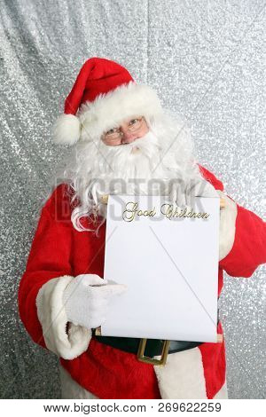 Santa Claus. Santa Claus with his Naughty or Nice List of Good or Bad Children. Santa Holds his list. text is removable and replaceable with your own. room for text.