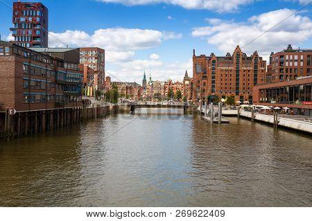 Hamburg, Germany - August 17, 2016 - Elbe River, Bridge And Buildings  At Speicherstadt (warehouse)