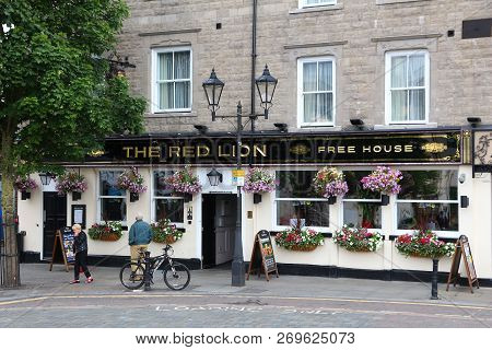 Doncaster, Uk - July 12, 2016: People Walk By The Red Lion Pub In Downtown Doncaster, Uk. It Is One