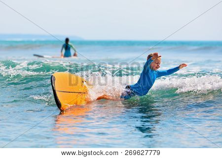 Happy Boy - Young Surfer Learning Ride And Fall From Surfboard With Fun. Active Family Lifestyle. Ki