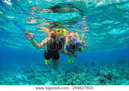 Happy Family - Mother, Kid In Snorkeling Mask Dive Underwater With Tropical Fishes In Coral Reef Sea