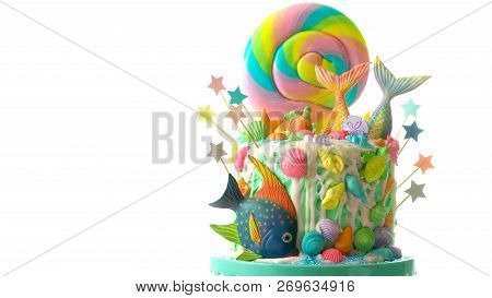 Mermaid Theme Candyland Cake With Glitter Tails, Shells And Sea Creatures.