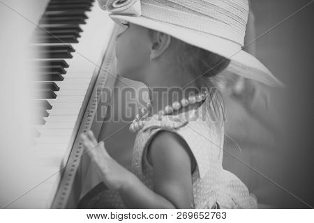 Child In Vintage Pink Hat, Dress, Bead Necklace At Keyboard. Girl Play Digital Piano. Music Class, S