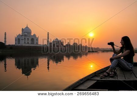 Woman Watching Sunset Over Taj Mahal From A Boat, Agra, India. It Was Build In 1632 By Emperor Shah