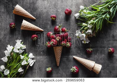 Strawberries In Cups On A Dark Gray Background With Waffles And White
