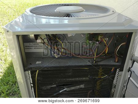 Residential Air Conditioner And Heat Pump Unit With One Side Of The Case Removed For Repair, Exposin