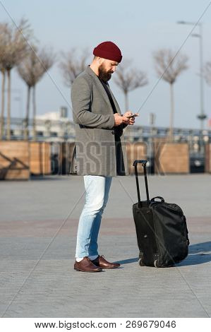 Let Travel Begin. Traveler With Suitcase Waiting Transportation To Airport Railway Station. Ready To