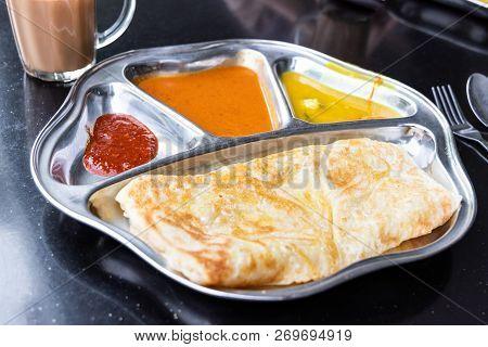 Roti Prata Or Canai Set With Curry, Dhal And Sambal
