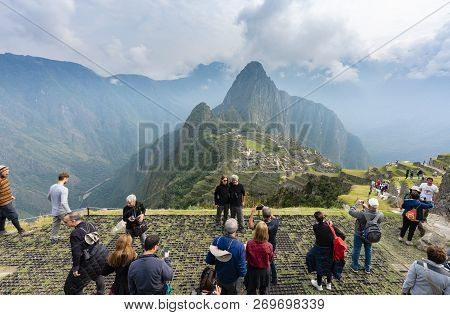 Machu Picchu, Peru - Sep 14, 2018: Tourist Visiting And Taking Photos At Machu Picchu In Peru