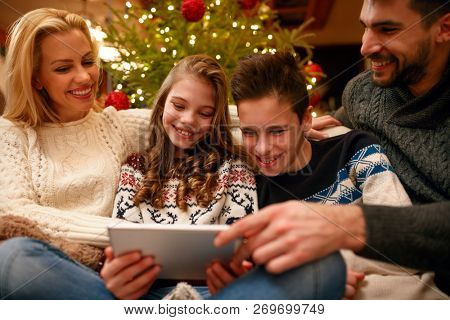 Christmas time- fun family with digital tablet on holiday