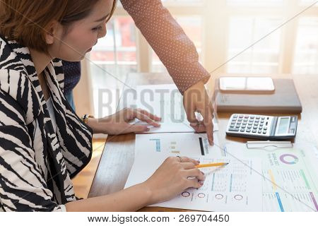 Business And Finance Concept Of Office Working, Businesswoman Discussing Sale Analysis Chart