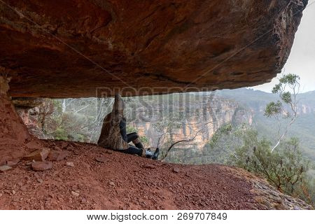 Sitting In The Undercliff Ledge With Views Of The Blue Mountains Escarpment And Valleys