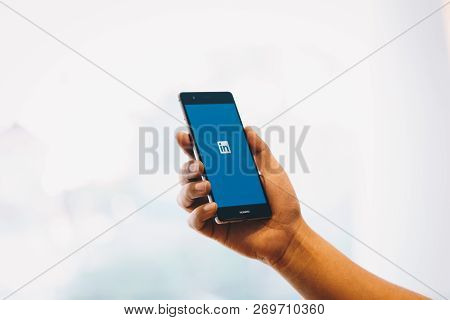 Chiang Mai, Thailand - Oct. 28,2018: Man Holding Huawei Mobile Phone With Linkedin Application On Th
