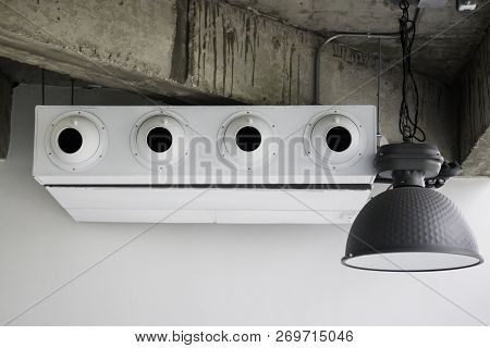 White Air Conditioner In Loft Room, Stock Photo