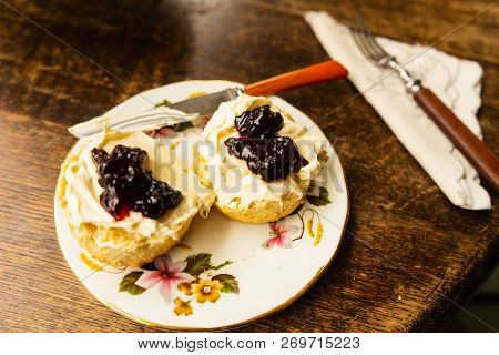 Traditional British Scone With Clotted Cream And Jam Table Setting