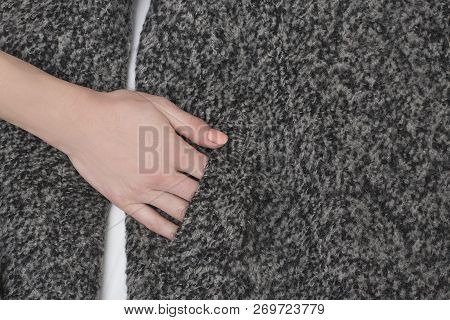Female Hand In Pocket Of Gray Wool Coat. Close Up. Fashionable Concept
