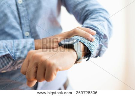 Closeup Of Business Man Checking Time On Wristwatch. Entrepreneur Waiting For Someone. Time Manageme